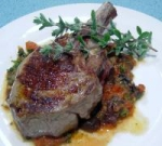 Veal cutlets with olive, tomato and anchovy sauce picture