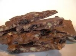 Chocolate Bark Filled With Pine Nuts and Dried Cherries picture