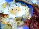 Baked Eggs on a Bed of Potatoes With Bacon picture