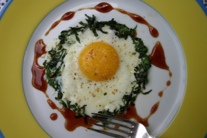 one perfect egg with herbs white pepper and honey balsamic vinegar picture