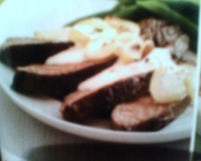 smothered sirloin steak in parmesean peppercorn sauce picture
