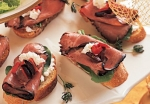 Roast Beef Crostini with horseradish, bleu cheese, walnuts, and choppe picture