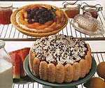 cream cheese pie topped with peaches and blackberries picture