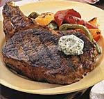 rib-eye steaks with bell peppers and gorgonzola butter picture