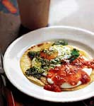 fried eggs on corn tortillas with two salsas (huevos divorciados) picture
