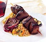 peruvian-style beef kebabs with grilled onion and zucchini picture