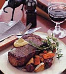 roasted rib-eye steak with herbed mustard sauce and root vegetables picture
