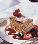 caramel mousse napoleon with caramel sauce and berries picture