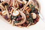 posole with southern greens, chayote, dried cherries, and pecans picture