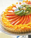cheesecake tart with tropical fruits picture