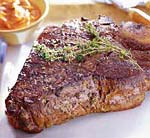 grilled porterhouse steak with paprika-parmesan butter picture