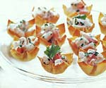 mango-curry shrimp salad in wonton cups picture