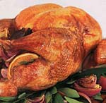 roast turkey with oranges, bay leaves, red onions, and pan gravy picture