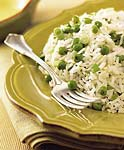 jasmine rice with green onions, peas, and lemon picture