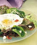 mixed greens with crispy bacon, goat cheese, and fried egg picture