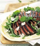 porterhouse steaks with arugula and parmesan cheese picture