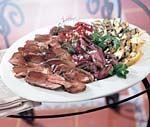 grilled butterflied leg of lamb and vegetables with lemon-herb dressing picture