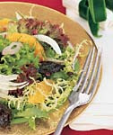 prune, orange, fennel, and red onion salad with mixed greens picture