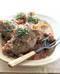 lamb shanks with tomatoes and fresh herbs picture
