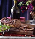 mortadella-stuffed pork loin with rosemary roasted potatoes picture
