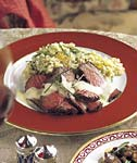 grilled beef tenderloin with roasted garlic sauce and leek-tomato quinoa picture