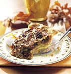 bourbon-orange pecan pie with bourbon cream picture