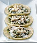 soft fried tortillas with tomatillo salsa and chicken picture