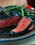 black-pepper-crusted wagyu new york steaks with black truffle vinaigrette picture