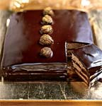 dark chocolate-caramel cake with gold-dusted chestnuts picture