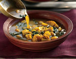 curried potato and spinach soup with onion salsa and minted yogurt picture