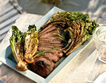 grilled leg of lamb with curly endive and romaine picture