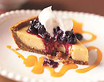 key lime pie with passion fruit coulis and huckleberry compote picture