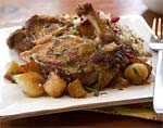 cider-braised pheasant with pearl onions and apples picture